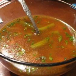 Veggie Soup with Basil Sauce Recipe - A tomato-basil pesto is added to this vegetarian kidney bean and red potato soup with corn, green beans, and carrots, seasoned with tamari.