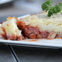 Baked Corn Beef Hash Recipe - Layered ingredients baked in the oven make for an easy, quick and tasty meal that's good for those long cold winter nights.