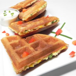 Savory Southwestern Waffles Recipe - Corn and green chile peppers make these quick and easy Southwestern waffles a spicy and savory treat fit for either breakfast or dinner.