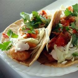 Fish Tacos Recipe - Beer battered cod are the star of these fresh and tasty fish tacos, served in corn tortillas with shredded cabbage and a zesty white sauce.