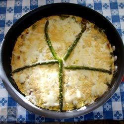 Asparagus and Mushroom Frittata Recipe - Fresh asparagus and mushrooms are wonderful when baked together in a cheesy frittata!