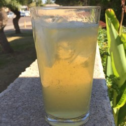 Jess' Party Punch Recipe - This citrusy cocktail packs a punch with beer, vodka, and lemon-flavored rum.