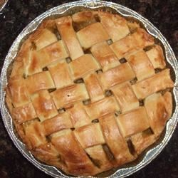 Apple Pie III Recipe - Sliced Granny Smith apples are sugared, sprinkled with cinnamon  and tucked into the fridge overnight. A lovely pastry is rolled out, placed in the pan and gets filled with the apple mixture. The top crust is then added and the pie baked to perfection.