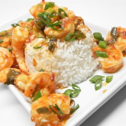 Spicy Sambal Shrimp Recipe - Shrimp is tossed in a spicy, buttery sauce made with sambal oelek in this easy Indonesian-inspired dish served over steamed sushi rice.