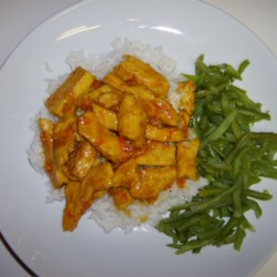 Orange Curried Chicken Recipe - Curry-spiked orange marmalade makes an exotic, easy glaze for baked chicken.