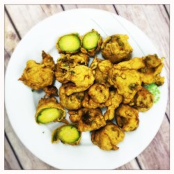 Brussels Sprout Pakora Recipe - These bite-sized Brussels sprout pakora are a quick and easy Indian-inspired appetizer made with chickpea flour, cumin, and a hint of spice.