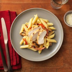 Barilla Gluten Free Penne with Cajun Chicken Recipe - Serve up a spicy, delicious gluten free meal with this creamy gluten free penne tossed with Cajun chicken, colorful red peppers, mushrooms and onions.