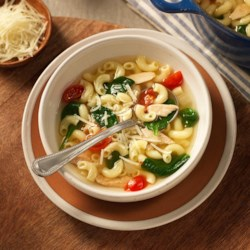Gluten Free Chicken Noodle Soup Recipe - This easy gluten free chicken noodle soup is flavored with onion, cherry tomatoes, baby spinach, white wine and Romano cheese.