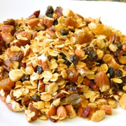Maple Pecan Granola with Dried Fruit Recipe - Homemade maple pecan granola with plenty of spiced dried fruit is a crunchy topping for yogurt or great by itself!