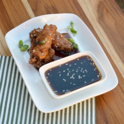 Spicy Asian-Style Wing Sauce Recipe - Wing sauce with an Asian flair, thanks to soy sauce, sesame seeds, and ginger paste, is perfect for wings during football games.