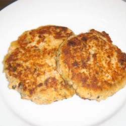 Salmon Cakes III Recipe - Salmon patties with onion and fresh bread crumbs fried in hot oil.  Simple and delicious.