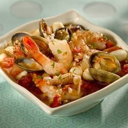 Bodega Bay Cioppino Recipe - This stew brings back childhood memories of Northern California and new buckets brimming with crab and baskets of sourdough bread.  Rich, red, and very messy, it is now a New Years tradition at my house. Serve in large bowls with sourdough bread on the side. Never any leftovers!