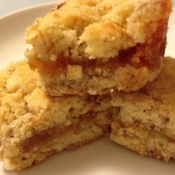 Orange Marmalade Bars Recipe - Very moist and fruity, these bars go great with coffee.