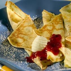 Easy Swedish Pancakes Recipe - This recipe is so delicious and easy to make.  I come from a really Swedish town - Rockford, Illinois - where Swedish pancakes are a favorite for Sunday morning breakfast.  My Dad used to make these for us at home for a special treat. Serve with butter and maple syrup, or lingonberries if you've got them.