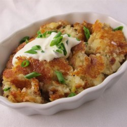 V's Fried Mashed Potatoes Recipe - Boiled potatoes are mashed and cooked in butter and olive oil in this crispy, fried mashed potatoes recipe.