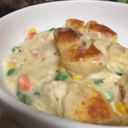 Chicken Pot Pie Bubble Bake Recipe - Your kids will love this quick and easy version of pot pie using prepared biscuit dough and canned soup.