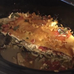 Easy Slow Cooker Lasagna Recipe - This slow cooker lasagna recipe uses layers of noodles, Swiss chard, and mozzarella cheese with mixtures of seasoned tomatoes and ricotta cheese for an simple way to prepare an American classic.