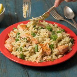 Salmon Scampi and Rice Recipe - Chunks of tender salmon fillet and green beans with a delicious herb and butter rice are ready to serve in just 30 minutes.