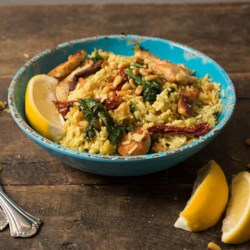 Tuscan Chicken Skillet with Kale & Sun-Dried Tomatoes Recipe - This hearty one-skillet dinner with chicken, kale, and sun-dried tomatoes makes a perfect busy weeknight meal.