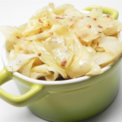 Beer Braised Cabbage Recipe - Cabbage is braised in a savory beer and mustard sauce until tender in this quick and easy recipe for a side dish that pairs well with pork.