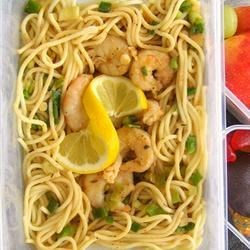 Win's Shrimp and Spaghetti Recipe - Fresh shrimp simmered in butter, teriyaki sauce and Creole-style seasoning, served over pasta.