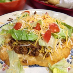 Indian Tacos Recipe - Indian tacos of homemade fry bread topped with chili, cheese, lettuce, and tomato are a favourite at Aboriginal Pow Wows all summer long.