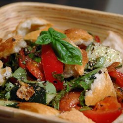 Mid-Summer Italian Bread Salad Recipe - A crusty rosemary bread works nicely for this classic Italian salad. The bread - pulled into bite-sized pieces - tomatoes, cucumbers and red onions, are tossed with fresh herbs and just enough vinegar and oil to give them a nice glistening. Four generous servings.