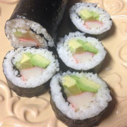 Kimbop (Korean Sushi) Recipe - These sushi rolls are filled with fried egg, carrot, cucumber, ham, and American processed cheese for this alternative to traditional Japanese sushi.