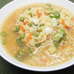 Alex's Rice Soup Recipe - You can make this recipe for a hearty rice soup with just a few simple ingredients; instant rice, chicken broth, chicken, and frozen peas.