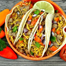 Mexican Rice & Beef Tacos Recipe - These beef tacos with bell peppers, onion, and Mexican rice are quick and easy--just what you need after a busy day.