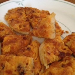 Crabmeat Canapes Recipe - Easy and wonderful crab canapes made on English muffins. They can be made and frozen ahead of time. Cooked pork sausage may be substituted for crabmeat.