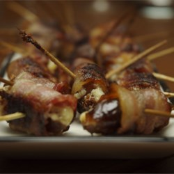 Bacon Wrapped Dates Stuffed with Blue Cheese Recipe - Dates are stuffed with blue cheese, wrapped in bacon and baked until crisp. These are delicious and very easy to make for a party. You can serve them at room temperature, so it is okay to make a few hours in advance!