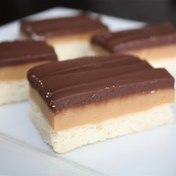 Caramel Shortbread Squares Recipe and Video - These cookies consist of a shortbread crust, firm caramel center, and a milk chocolate top. They are super-easy to make and they take only 20 minutes to bake.