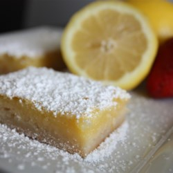 Lemon Squares I Recipe - These lemon-walnut bars are a perfect treat for a hot summer day--or any time you want a blast of citrus sunshine.