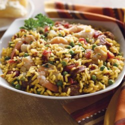 Skillet Paella Recipe - Feel like Spanish tonight? This paella recipe makes it easy with Zatarain's yellow rice, shrimp, smoked sausage, onion and peas. If you want to give it a little more South Louisiana flavor, use andouille sausage.