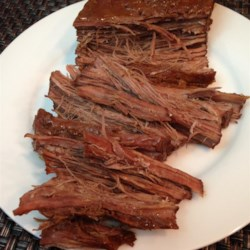 Oh So Tender Brisket Recipe - Beef brisket seasoned with dry onion soup, liquid smoke and garlic powder then baked slowly until tender.