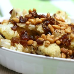 Roasted Cauliflower with Dates and Pine Nuts Recipe - Roasted cauliflower tossed in a buttery topping with pine nuts and dates is a fancy way to dress up cauliflower for a quick side dish.