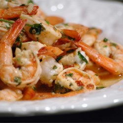 Grilled Shrimp Scampi Recipe and Video - Shrimp marinated in lemon, garlic, and parsley for 30 minutes, then grilled. Can be used as an appetizer or main dish. This recipe also works well for scallops.