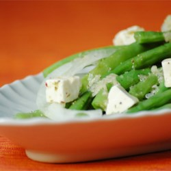 Green Bean and Feta Salad Recipe - Sweet onion, fresh green beans, feta cheese, garlic and several vinegars mingle in this piquant salad.