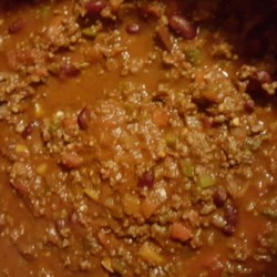 Chuck's Super Chili Recipe - Hot Italian sausage and ground beef are the base of this spicy chili made with red wine, colorful bell peppers, tomatoes, kidney beans, and both jalapeno and chipotle chiles. It makes enough to feed a crowd or to freeze extra for easy weeknight meals.