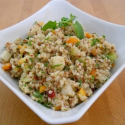 Winter Fruit Salad Recipe - Bosc pears, watercress, and cucumbers are folded into a bowl of quinoa, and then napped with a sensational dressing whipped up with diced Kumquats, olive oil, cilantro, and lemon juice.