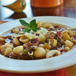 Best Italian Sausage Soup Recipe - Italian sausage, zucchini and spinach fettucine are featured in this beef broth soup seasoned flavored with red wine, basil and oregano.