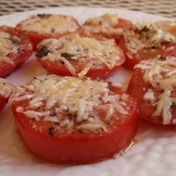 Italian Nutthouse Broiled Tomatoes Recipe - This Italian inspired appetizer is quick, tasty, and beautiful to the eye. Tomato slices are drizzled with olive oil, then sprinkled and broiled with parmesan cheese, oregano, and garlic.