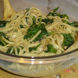 Linguine with Spinach and Brie Recipe - Who says quick and easy recipes can't have gourmet flavor? In this simple pasta preparation, bacon, spinach, garlic, and brie cheese combine to create a simply luscious dish.