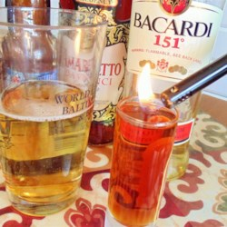 Flaming Doctor Pepper I Recipe - This drink is actually considered a shooter, meaning don't hold back, guzzle it down. Amaretto and 151 proof rum are set on fire and dropped into a glass of beer.