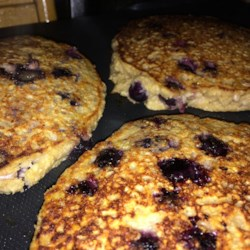 Saturday Morning Blueberry Pancakes Recipe - Blueberry pancakes made with wheat flour, banana, and granola, are a hearty way to start the weekend mornings.