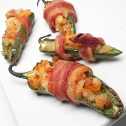 Lobster Bacon Jalapeno Poppers Recipe - Up your richness game by adding lobster to your bacon-wrapped jalapeno poppers as done with this recipe.