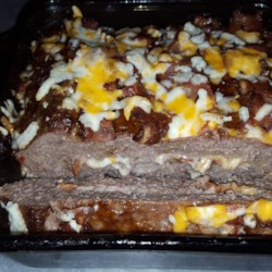 Man Loaf (Variation of the Meatloaf) Recipe - Bacon, Cheddar cheese, and Swiss cheese turn this barbeque sauce-slathered meatloaf into an event!