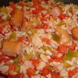 Hot Dog Creole Recipe - Stir sliced hot dogs into a zippy sauce of green pepper, onion, and stewed tomatoes to create this budget friendly creole-style dinner in no time.