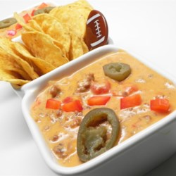 Game Day Jalapeno Cheese Dip Recipe - This hot and cheesy dip gets a zip from jalepeno peppers and spicy sausage.  Keep it hot in a slow cooker, and serve with lots of crisp tortilla chips.